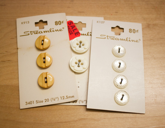 golden yellow buttons, white decorative buttons (the gold ones are my favorite!)
