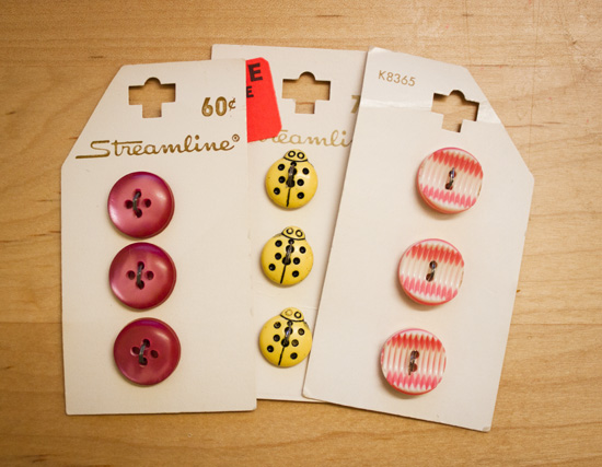 pink buttons, yellow bug buttons