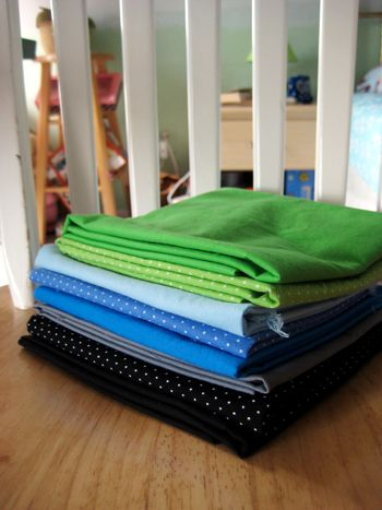 blues, greens fabric pile