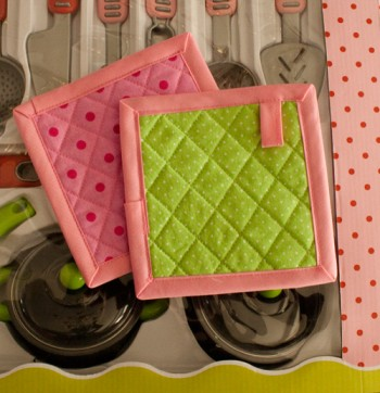 mini potholders made using the mitred corners with bias tape tutorial