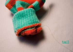 stitching buttons to knit: step 4