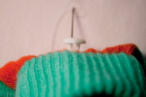 stitching buttons to knit: step 6